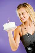 Cake: Woman Holds Birthday Cake To Side — Stockfoto
