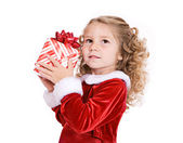 Christmas: Cute Girl Guessing What Is In Gift — Stok fotoğraf