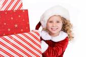 Christmas: Santa Girl Peeks Around Big Stack Of Christmas Presen — Foto de Stock