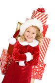 Christmas: Little Girl In Front Of Large Stack Of Wrapped Gifts — Stockfoto