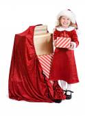 Christmas: Little Girl Stands Next To Sack Of Holiday Presents — Stockfoto