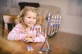 Hanukkah: Girl Sitting At Table Ready To Light Candles — Foto Stock