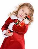 Christmas: Little Girl Gives Nutcracker A Hug — Stockfoto