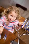 Hanukkah: Little Girl Putting Candles Into Menorah — Stock Photo