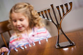 Hanukkah: Focus On Hanukkah Menorah With Girl In Back — Stock Photo