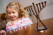 Hanukkah: Focus On Hanukkah Menorah With Girl In Back — Zdjęcie stockowe