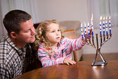 Hanukkah: Girl And Parent Light Hanukkah Candles Together — Stockfoto
