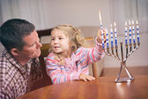 Hanukkah: Girl And Parent Light Hanukkah Candles Together — Foto de Stock