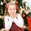 Christmas: Surprised Little Girl In Front Of Christmas Tree — Stock Photo #56336831