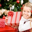 Christmas: Little Girl Giggles Over Christmas Gift — Stock Photo #56337209