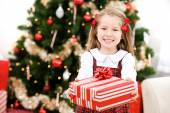 Christmas: Cute Holiday Girl Holds Out Christmas Gift — Foto Stock