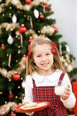 Christmas: Little Girl Putting Out Milk And Cookies For Santa — Foto Stock