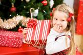 Christmas: Little Girl Giggles Over Christmas Gift — Foto Stock