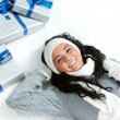Winter: Snowy Girl with Christmas Gifts — Stock Photo #57591045