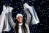 Winter: Holding Up Shopping Bags — Stockfoto