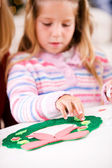 Christmas: Girl Sticking Parts On Foam Holiday Wreath Craft — Stockfoto