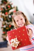 Christmas: Girl Holds Out Pretty Wrapped Christmas Gift — Zdjęcie stockowe