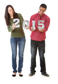NYE: Young Couple Holding Numbers For New Year 2015 — Stockfoto