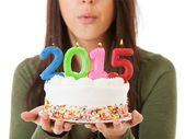NYE: Woman Blowing Out Candles On 2015 Birthday Cake — Stockfoto