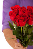 Valentine: Holding Out A Dozen Roses In Bouquet — ストック写真