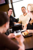 Coffee: Woman and Men Flirting in Coffee Shop — Stock Photo