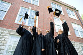 Graduation: Graduates Toss Caps in Air — Stock Photo