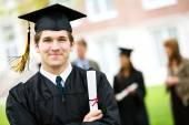 Graduation: Cheerful Graduate with Diploma — Stock Photo