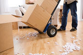Moving: Man Uses Handcart To Move Boxes — Stock Photo