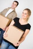 Moving: Smiling Couple Carrying Boxes — Stock Photo