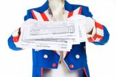 USA: Uncle Sam Holding Out Tax Forms — Stock Photo