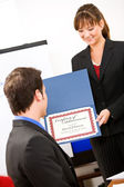 Business: Manager Presents Employee with Award — Stok fotoğraf