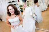 Bride: Woman Trying On Wedding Gown With Help Of Saleswoman — Stock Photo