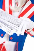 USA: Anonymous Uncle Sam Holding Tax Forms — Stock Photo