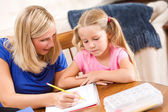 Student: Mother Showing Girl How To Complete Problem — Stock Photo