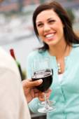 Wine: Focus On Glass Of Wine As Couple Talks — Stock Photo