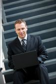 Business: Businessman Takes A Break From Office And Works On Sta — Stock Photo