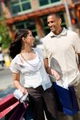 Shopping: Young Shopping Couple Laughing And Walking — Stock Photo