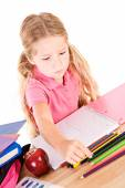 Education: Little Girl Using Colored Pencils In Notebook — Stock Photo