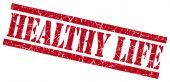 Healthy life red grungy stamp on white background — Stock Photo