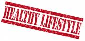Gesundes Leben red grunge Stempel auf weißem Hintergrund — Stockfoto