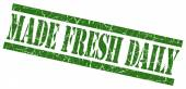 Made fresh daily green grungy stamp on white background — Foto Stock