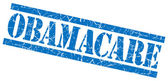 Obamacare blue grungy stamp on white background — Stock Photo
