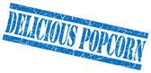 白で隔離されるおいしいポップコーン青いグランジ スタンプ — ストック写真