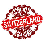 Made in Switzerland red stamp isolated on white background — Stock vektor