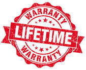 Lifetime warranty red grunge seal isolated on white — Stock Photo