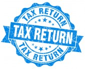 Tax return blue grunge seal isolated on white — Stock Photo