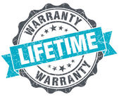Lifetime warranty vintage turquoise seal isolated on white — Stock Photo