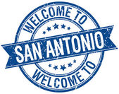 Welcome to San Antonio blue round ribbon stamp — Stock Vector