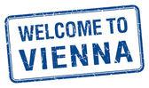 Welcome to Vienna blue grunge square stamp — 图库矢量图片