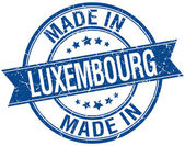 Made in Luxembourg blue round vintage stamp — Stock Vector
